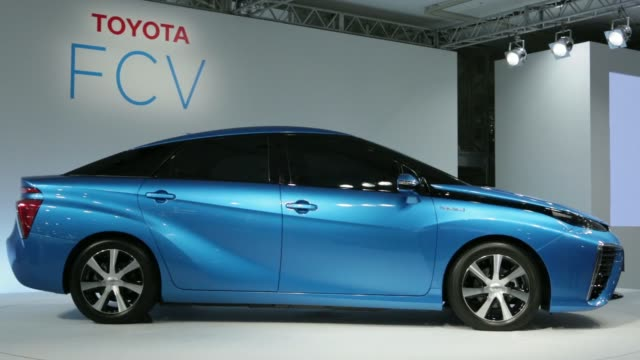 The Toyota Motor Corp fuel cell vehicle stands on display during a news conference in Tokyo Japan Wednesday June 25 The Toyota Motor Corp logo is...