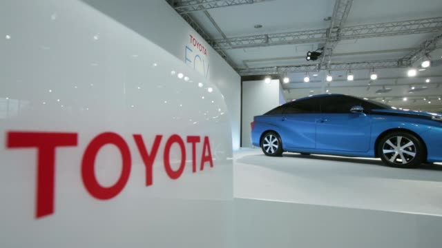 The Toyota Motor Corp logo is displayed near the companys fuel cell vehicle during a news conference in Tokyo Japan on Wednesday June 25 The Toyota...