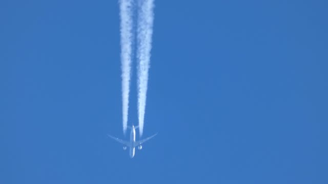 the trace of the plane in the sky - vapour trail stock videos & royalty-free footage