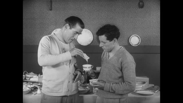 1927 The track and field team spikes man's (Buster Keaton) tea