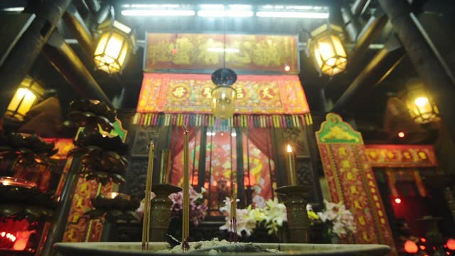 the traditional burning of incense inside the man mo temple in hong kong - low-angle shot - ハリウッドロード点の映像素材/bロール