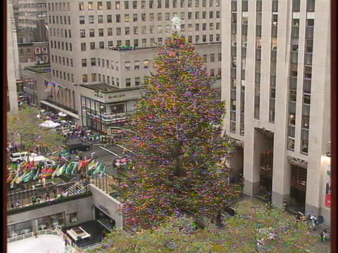 the traditional christmas tree decorates 56 rockefeller center in new york city - rockefeller center christmas tree stock videos & royalty-free footage