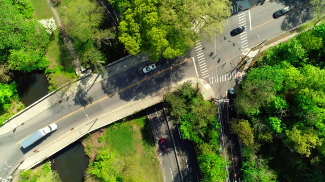 The traffic on the intersection at the bridge across the Bronx River Parkway in Bronxville, Westchester County, New York.