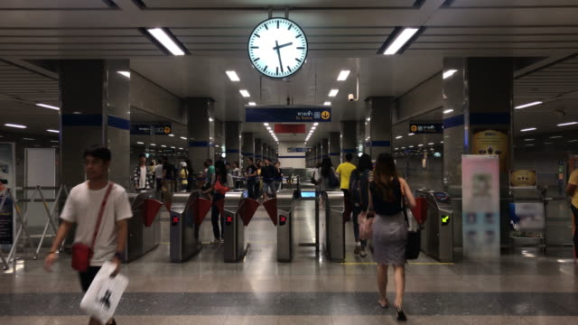 the traffic people pass ticketing gate in mrt metro bangkok,thailand - arrival stock videos & royalty-free footage