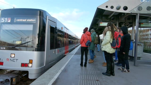 the train arrives at the metro station in amsterdam. - commercial land vehicle stock videos & royalty-free footage