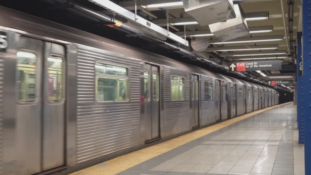 the train departed from canal street subway station in new york city deserted because of covid-19 coronavirus outbreak. - underground train stock videos & royalty-free footage