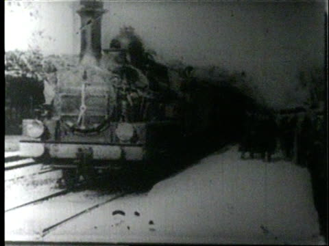 the train station and tracks at lyon locomotive arrives just passing camera full length cars pass / station attendant runs alongside passengers... - 19th century stock videos & royalty-free footage
