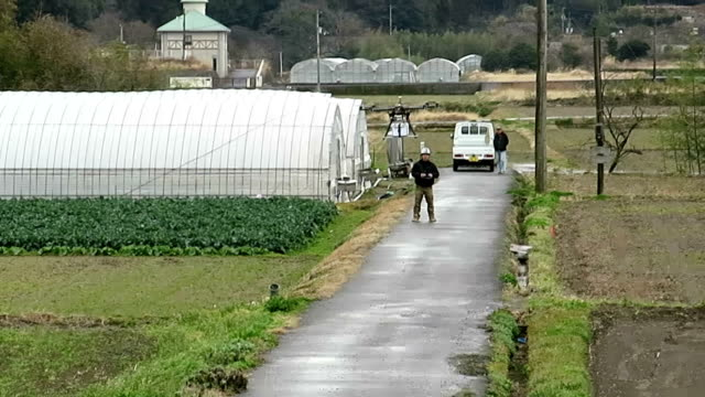 the transport ministry tests a drone in tokushima prefecture western japan on feb 24 to deliver parcels containing food items to elderly households... - tokushima prefecture stock videos & royalty-free footage