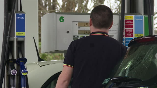 the transport secretary has demanded an investigation into the prices charged for petrol at motorway service stations fuel can cost up to 19 pence... - petrol stock videos & royalty-free footage