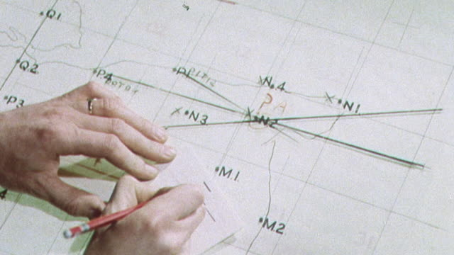 1962 montage the triangulation team at the royal observer group headquarters coordinating, calculating, and plotting nuclear bomb blast information in a cold war training exercise / united kingdom - 冷戦点の映像素材/bロール