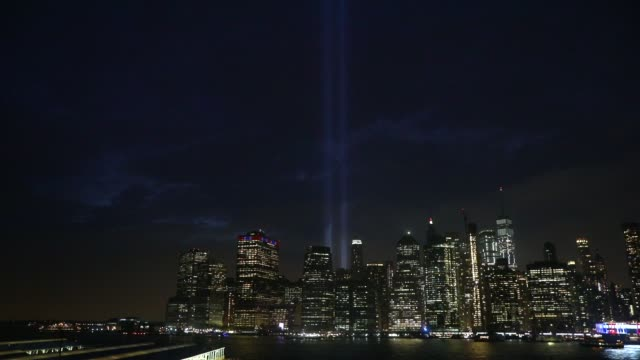 the 'tribute in light' memorial lights up lower manhattan near one world trade center on september 11 2018 in new york city the tribute at the site... - annual event stock videos and b-roll footage
