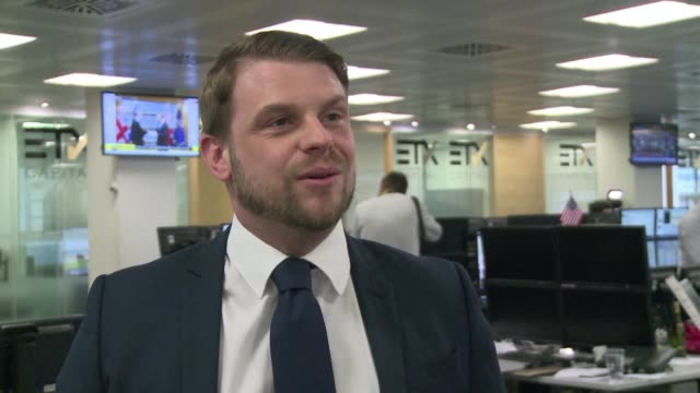 the triggering of article 50 had a pretty muted reaction on the markets of the london city explains david papier head of sales trading at etx capital - papier stock videos & royalty-free footage