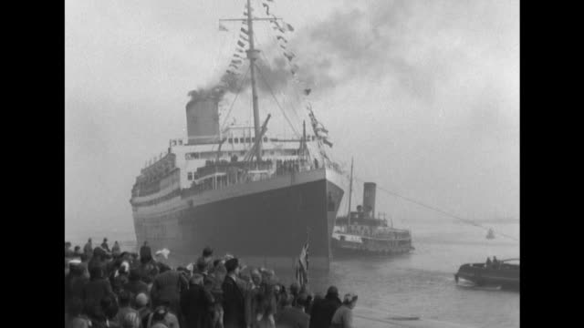 the troop ship asturias arrives at southampton carrying british troops who had been held prisoners of war in korea - korean war stock videos & royalty-free footage