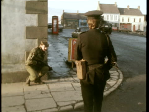 The Troubles in Crossmaglen NORTHERN IRELAND County Armagh Crossmaglen A/V Crossmaglen in green countryside A/V Army post with tall fence round it CM...