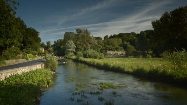 the trout river at bibury, gloucestershire - cotswolds stock videos & royalty-free footage