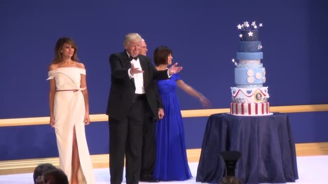 The Trump and Pence families exit the Inaugural Ball Stage after sharing a dance