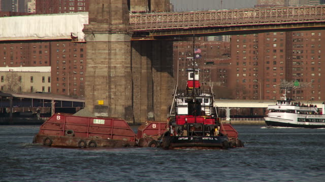 The Tug Boat Captain D Pushes A Barge Full Of Gravel Up The