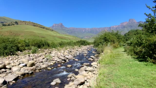 The Tugela river flowing below the Drakensberg Mountains