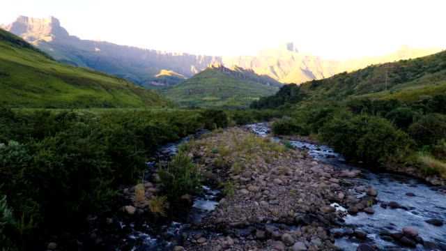 The Tugela river flowing from the might Amphitheatre and the Drakensberg Mountains, Kwa-Zulu Natal, South Africa