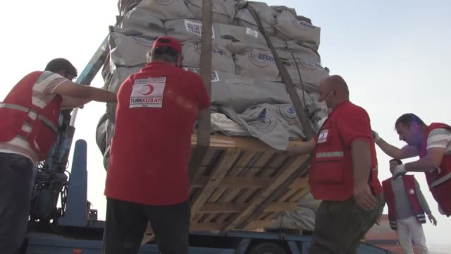 the turkish red crescent set up 45 tents for quake-hit iraqis at the yard of a girls' dormitory in halabja district of sulaymaniyah, iraq on november... - red cross stock videos & royalty-free footage