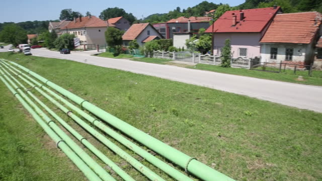 the tuzla thermal power plant operated by statecontrolledjp elektroprivreda bih or epbih in tuzla slag pipes near the power plant in tuzla bosnia... - {{relatedsearchurl('capsule pipeline')}} stock videos and b-roll footage
