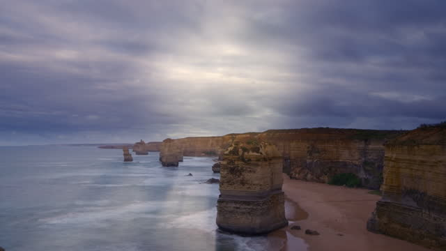 the twelve apostles on a stormy day, fast moving clouds pass above - boulder stock videos & royalty-free footage