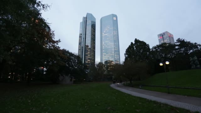 the twin tower skyscraper headquarters of deutsche bank ag stand in frankfurt germany on friday oct 24 gvs of the towers at night - deutsche bank stock videos & royalty-free footage