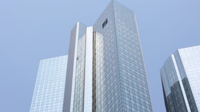 The twin tower skyscraper headquarters of Deutsche Bank AG stand in Frankfurt Germany on Saturday June 6 2015