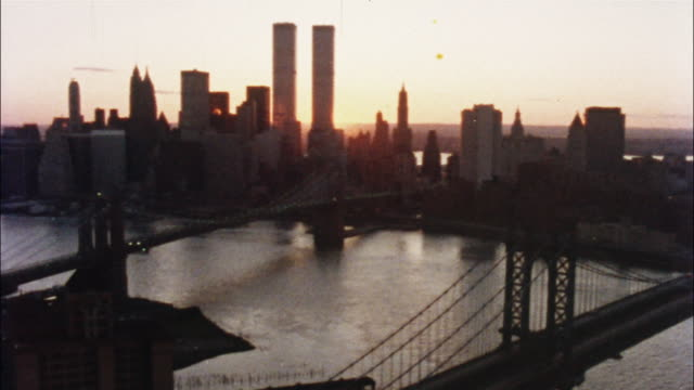 the twin towers of the world trade center and other skyscrapers rise above new york city. - world trade centre manhattan stock videos and b-roll footage