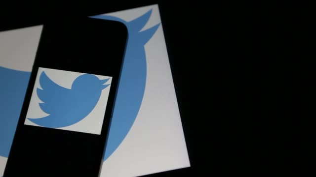 the twitter inc logo is displayed on mobile devices in washington dc shots pan across several mobile devices including a laptop and a smartphone... - logo stock videos & royalty-free footage
