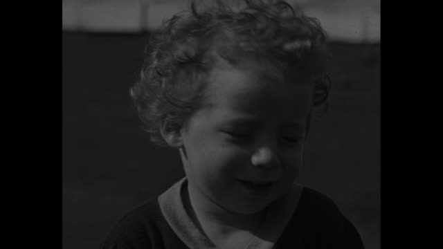 stockvideo's en b-roll-footage met the two woods twins / cu smiling johnny woods who was raised scientifically in a twin study of infant development / cu jimmy woods who was raised... - geestelijke gezondheidszorg