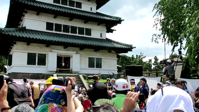 the twohundredyear old tower of hirosaki castle in aomori prefecture at the northern tip of japan's honshu main island was jacked up on sunday august... - honshu stock videos and b-roll footage