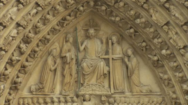 the tympanum of the last judgment adorns the entrance of notre dame de paris, france. - relief carving stock videos & royalty-free footage