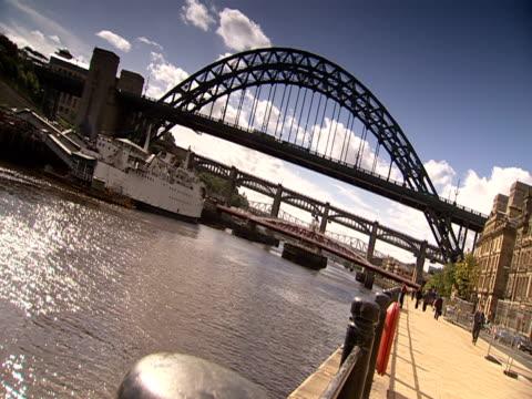 the tyne bridge spans the river tyne. - tyne bridge stock videos & royalty-free footage