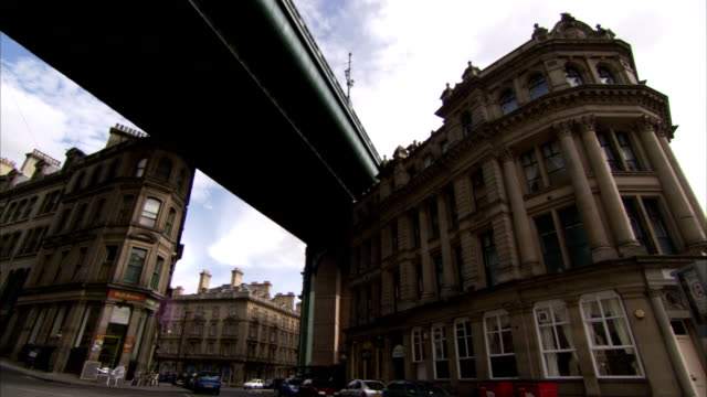 the tyne bridge sweeps over victorian buildings in newcastle-upon-tyne. available in hd. - tyne bridge stock videos & royalty-free footage