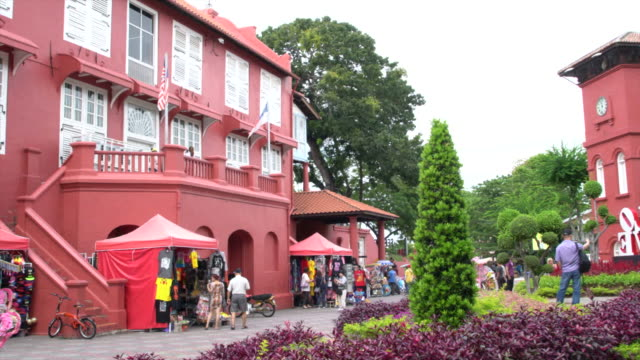 the typical red buildings in the stadthuys, a historical place situated in the heart of malacca city, malaysia - malacca stock videos and b-roll footage