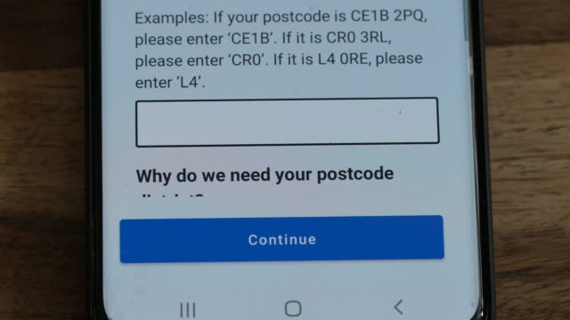the uk governments new test and trace application is displayed on a handheld device on september 24 2020 in london england the new nhs covid19... - applying stock videos & royalty-free footage