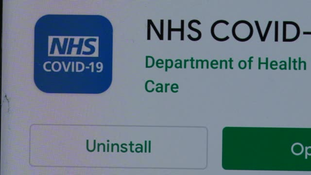 the uk governments new test and trace application is displayed on a handheld device, on september 24, 2020 in london, england. the new nhs covid-19... - computer software stock videos & royalty-free footage
