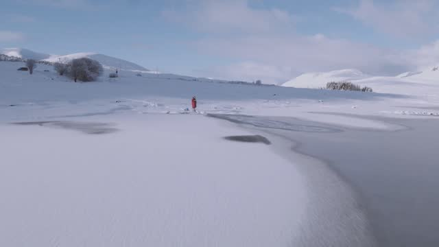the uk has experienced a cold start to 2018, but that did not not deter one swimmer from taking the plunge into a frozen loch glascarnoch in scotland... - swimming shorts stock videos & royalty-free footage