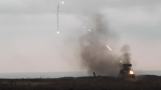 the ukrainian army took part in military exercises at the industrial port of mariupol tuesday close to the frontline with pro russian fighters - ukraine stock-videos und b-roll-filmmaterial