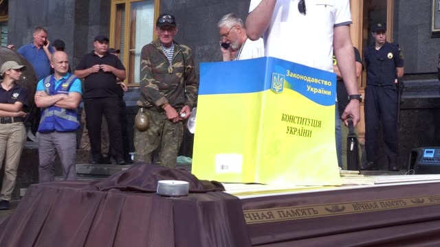 The Ukrainian Constitution is seen plased on a coffin during a symbolic funeral of the Ukrainian Constitution outside the Presidential office in Kiev...