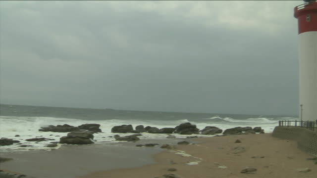 The Umhlanga Rocks Lighthouse overlooks the sea. Available in HD.
