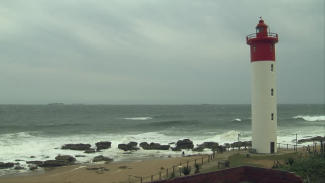 The Umhlanga Rocks Lighthouse overlooks the shore. Available in HD.