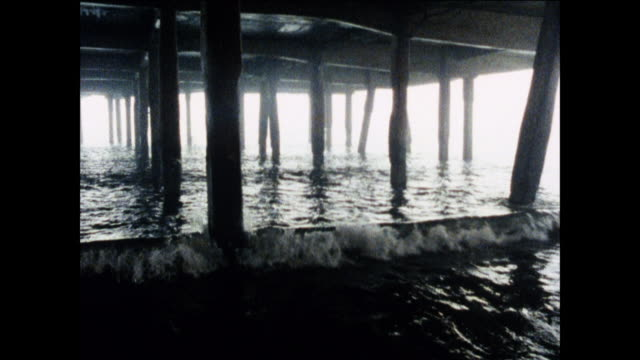 pan the underside of an english pier / united kingdom - peter greenaway stock videos & royalty-free footage