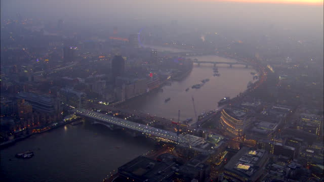 the unilever house glows near blackfriars bridge on a foggy evening in london. - greater london stock videos and b-roll footage