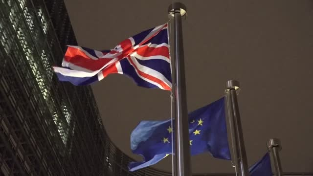 the union flag flies outside the european commission as boris johnson arrives in brussels for urgent brexit talks with ursula von der leyen. - flag stock videos & royalty-free footage