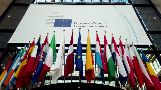 the union flag is seen among the flags of other eu member states in the eu council headquarters on april 10 2019 in brussels belgium british prime... - european union stock videos & royalty-free footage