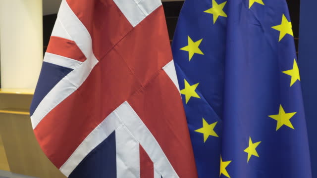 the union jack and european union flags together - european union stock videos and b-roll footage