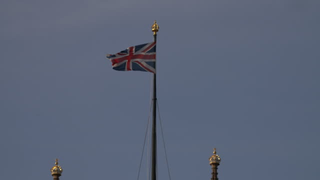 the union jack flag flying on top of victoria tower at the houses of parliament, london - politics icon stock videos & royalty-free footage