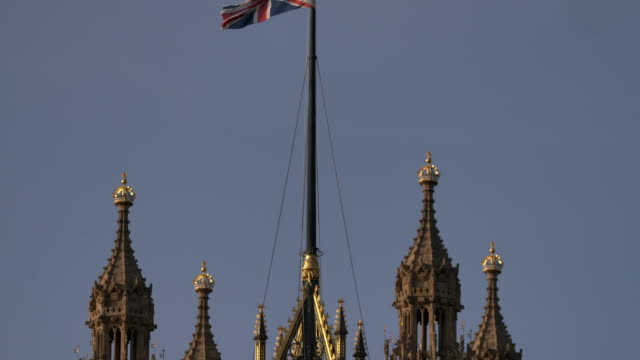 the union jack flag flying on top of victoria tower at the houses of parliament, london - victoria tower stock videos & royalty-free footage